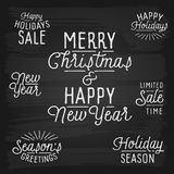 Hand drawn lettering slogans for Christmas and New Year Royalty Free Stock Photo
