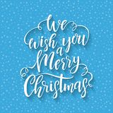 Hand drawn lettering We wish you a Merry Christmas. Vector design element for greeting card. Winter holidays poster and present box stock illustration