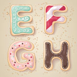 Hand drawn letters of the alphabet E through H. In the shape of delicious and colorful cookies stock illustration