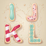 Hand drawn letters of the alphabet I through L. In the shape of delicious and colorful cookies royalty free illustration