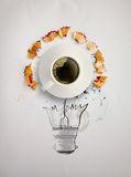 Hand drawn light bulb with pencil saw dust. And 3d cup of coffee on paper background as creative concept Stock Photo