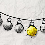 Hand drawn light bulb on wire doodle Stock Images