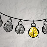 Hand drawn light bulb on wire doodle Stock Image