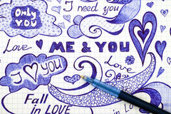 Hand drawn love doodles messages on checkered paper with pen Royalty Free Stock Image