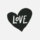 Hand drawn love lettering in black hand drawn heart. Sticker or label in the style of 80`s and 90`s. Royalty Free Stock Images