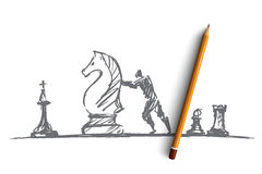 Hand drawn man moving huge chess figure Royalty Free Stock Images
