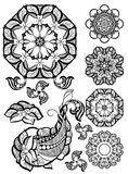 Hand-drawn mehendi ornamental elements. And mandala collection. Indian henna tattoo set. Oriental style decorative design templates. EPS 10 illustration Royalty Free Stock Image