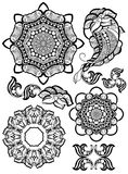 Hand-drawn mehendi ornamental elements. And mandala collection. Indian henna tattoo set. Oriental style decorative design templates. EPS 10 illustration Royalty Free Stock Photo