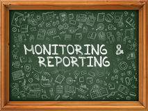 Hand Drawn Monitoring and Reporting on Green Chalkboard. Hand Drawn Doodle Icons Around Chalkboard. Modern Illustration with Line Style Stock Photo