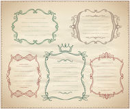 Hand drawn monogram vintage frames with place for text. On a paper Royalty Free Stock Images