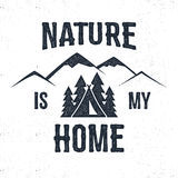 Hand drawn mountain advventure label. Nature is my home illustration. Typography design with trees, tent and mountain. Roughen style. Wanderlust vector tee Royalty Free Stock Image