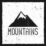 Hand drawn mountain poster. Wilderness old style typography label. Letterpress Print Rubber Stamp Effect. Retro mountain Stock Photo