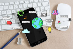 Hand-drawn multimedia icons on office background Royalty Free Stock Image