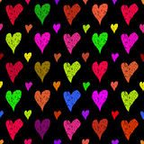Hand drawn multycolored hearts at black background seamless patt Royalty Free Stock Photo