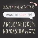 Hand drawn narrow font on chalkboard. Tall alphabet. Stock Photos