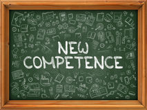 Hand Drawn New Competence on Green Chalkboard. Stock Photo