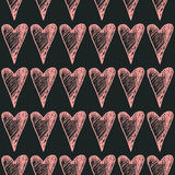 Hand drawn painted hearts seamless pattern.pink hearts on black background.ink illustration.ornament for Valentine`s day Royalty Free Stock Photography