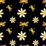 Hand-drawn with paints pearly chamomile and gold dragonflies on black background, seamless pattern. Hand-drawn with paints pearly chamomile and gold dragonflies Royalty Free Stock Image