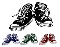 Hand drawn pair of black sneakers on the white Royalty Free Stock Image