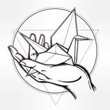 Hand drawn paper crane in a hand palm. Royalty Free Stock Photos