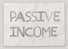 Hand drawn of  passive  income on crumpled paper Stock Images