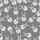 Seamless pattern with hares. Hand drawn pattern. Seamless vector texture. Surface with hares. Grey background Royalty Free Stock Image