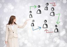 Hand-drawn people profile icons with open hand of businesswoman. Digital composite of Hand-drawn people profile icons with open hand of businesswoman stock photo