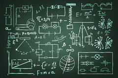 Hand drawn physics set. Chalkboard background image with science sketches and formulas Royalty Free Stock Photo