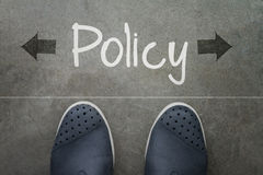 Hand drawn policy word on front of business man Stock Images