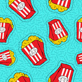 Hand drawn popcorn bucket patch icon pattern. Hand drawn seamless pattern with popcorn bucket stitch patch icons, cinema food badge or sticker background. EPS10 Royalty Free Stock Images