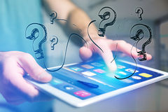 Hand drawn question mark icon going out a tablet interface of a Royalty Free Stock Photography