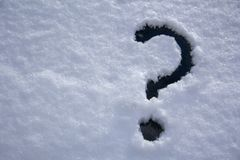 Hand drawn Question mark on snow concept for confusion, question stock photo