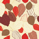 Vector illustration of red and brown leaves on light yellow background. Seamless pattern. Hand drawn red and brown leaves on light yellow background. Seamless royalty free illustration