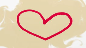 Hand drawn red heart on beige background stock footage