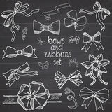 Hand drawn ribbons and bows set vector illustration. A collection of graphic ribbons and bows, design elements set on chalkboard Royalty Free Stock Image