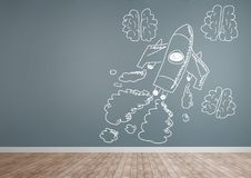 Hand-drawn rocket and brains on grey wall. Digital composite of hand-drawn rocket and brains on grey wall Royalty Free Stock Images