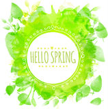 Hand drawn round frame text hello spring. Green watercolor splash texture with printed leaves. Artistic vector design for spring b Stock Images