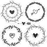 Hand drawn rustic vintage wreaths with hearts. Floral vector Stock Image