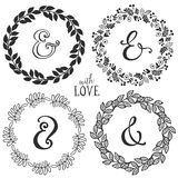Hand drawn rustic vintage wreaths with lettering and ampersand. Royalty Free Stock Images