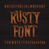 Hand drawn rusty vintage typeface. Retro alphabet font. Type letters and numbers on a rough wooden background. Royalty Free Stock Photos