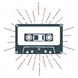 Hand drawn 90s themed badge with audio cassette tape grunge textured and vintage sunburst. Vector Stock Image