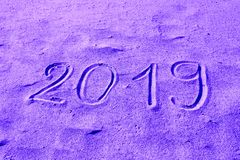 2019 hand drawn on the sand colored in purple. New Year is Coming or Holidays Catalog Abstract Background Design. stock photos