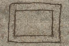 Hand drawn on sandy ground frame. Texture royalty free stock photos