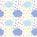 Hand drawn seamless pattern background with colorful watercolor drops and clouds. For kids. Royalty Free Stock Images