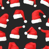 Hand drawn seamless pattern with Christmas hats on dark background. Royalty Free Stock Image