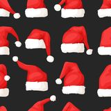 Hand drawn seamless pattern with Christmas hats on dark background. Royalty Free Stock Photos