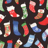 Hand drawn seamless pattern with Christmas socks for gifts.  Royalty Free Stock Images