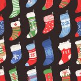 Hand drawn seamless pattern with Christmas socks for gifts. Holidays background. Abstract doodle drawing. Vector art. Hand drawn seamless pattern with Christmas stock illustration