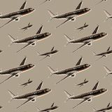Hand drawn seamless pattern of dark brown airplane in flight in color pencils style on a beige background royalty free stock photos