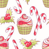 Hand drawn seamless pattern with doodle christmas cupcake, holly, candy cane and buttercream. Food background Royalty Free Stock Images